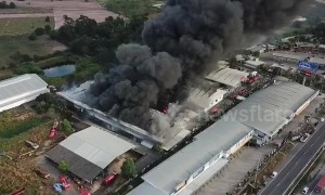 Dramatic drone footage shows massive plumes of black smoke from Thailand warehouse fire