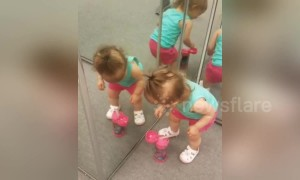 This little girl doesn't quite understand mirrors