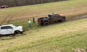 Ford Truck Pulls Brand New Toyota Tundra out of Rut
