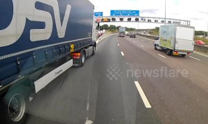 Dash cam footage shows lorry almost causing major accident on busy UK motorway
