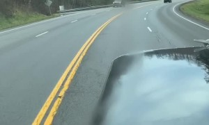 SUV Disappears over Guardrail