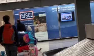 Dad Drags Daughter Through Airport