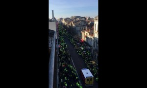 Yellow vest protests part to make way for an ambulance