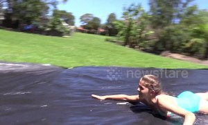 Young Australian girl makes slip 'n slide for cousins