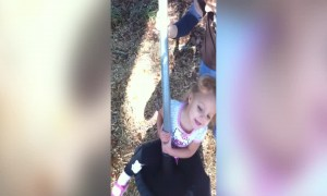 Little Girl gets Dizzy on the Playground