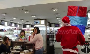 Santa 'drops' presents on people in holiday prank