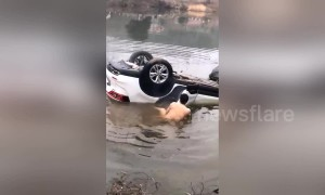 Man saves father and daughter trapped in car after vehicle loses control and dives into pond in southern China