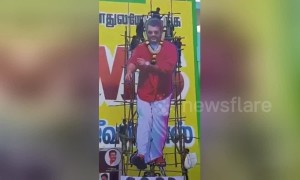 Actor cutout scaffolding collapses as fans climb on top in South India province
