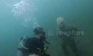 Fake skeleton, grandfather clock in strange underwater Arizona world