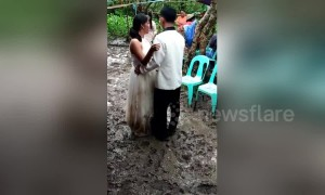 Newlyweds have 'muddy' first dance in typhoon-hit village