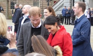 Meghan and Harry cuddle crying schoolgirl on first joint engagement of 2019