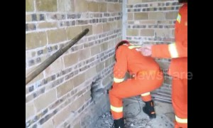 Firefighters cut free two-year-old trapped between two walls