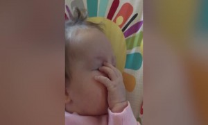 Baby Discovers her Hands!