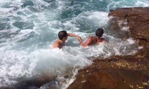 Daredevil teens plunge into rough ocean waters to cool off in sweltering Australian heat