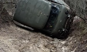 Utility Vehicle Gets Back Up After Being Stuck in a Rut