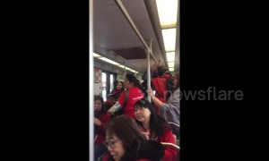 LA teachers break into rally chants on Metro enroute to second day of strikes
