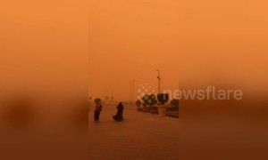 Incredible Cairo sandstorm dyes entire sky orange