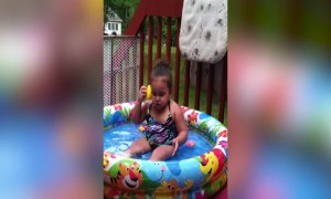 Little Girl Talks with Rubber Ducky