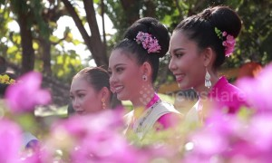 Beautiful scenes from umbrella festival in northern Thailand as local women wear traditional costume