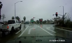 Running a Red Light on a Rainy Road