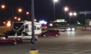 Police Pursue Car in Supercenter Parking Lot