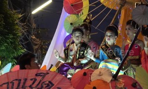 Thai locals wear traditional dress for evening parade at umbrella festival