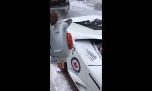 Fastest way to clear snow off a Lamborghini