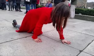 "Mystery of the ""lady in red"" filmed crawling across Parliament Square in London"