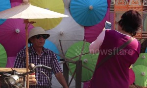 Tourists enjoy colourful umbrella festival in northern Thailand