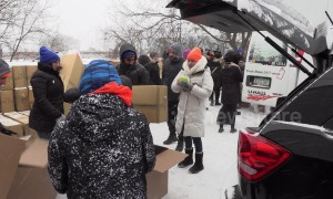 Volunteers in Toronto pack emergency supplies for the homeless during severe cold weather outbreak