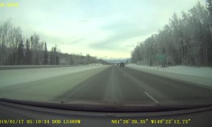Truck Slides into Snow Filled Median Strip