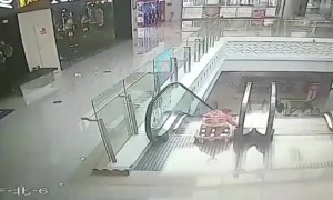 Heroic soldier runs to rescue infant falling down an escalator