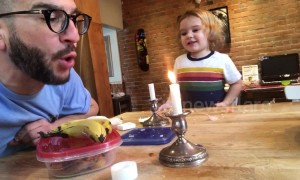 Dad entertains his kid by beatboxing with a candle flame