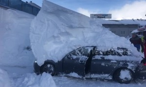Parked car reverses while under 6ft-high snowdrift in Austrian hotel car park