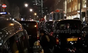 London black cab drivers block streets protesting at Tottenham Court Road
