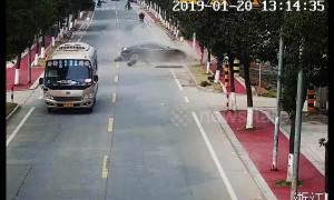 Street sweeper has near miss when out-of-control car smashes into a tree