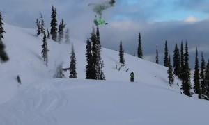 Snowmobile Rider Slips During Stunt