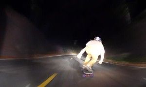 Skilled Nighttime Downhill Skateboarding