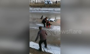 Villagers save man trapped in car that fell into icy river