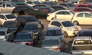 Drivers forced to PUSH vehicles to exit busy car park