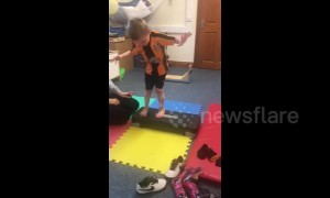 Inspirational moment boy with cerebral palsy walks without splints