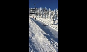Lazy snowboarder takes the drag lift to a whole new level