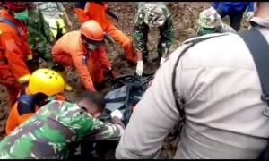 Search and rescue team evacuates landslide casualty in the wake of deadly Indonesia floods