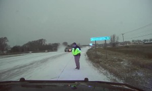 Police officer jumps out of the way of out-of-control vehicle