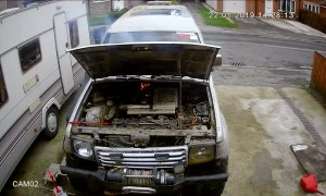 Man Rushes to Put out Fire Coming from Car