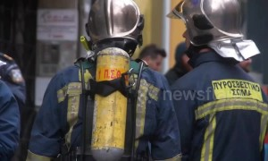 Man in Greek bank threatens to self immolate, set building alight