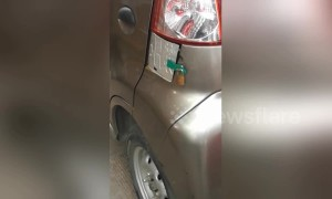 Electric car owner installs extra lock on charging socket to deter robbers