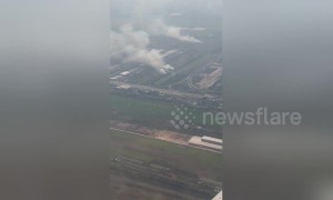Aerial footage shows Thai farmers burning crops in smog-ravaged Bangkok