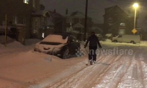 Canadian man goes skiing through Toronto streets during snowstorm