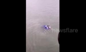 Good Samaritan rescues driver stuck in car sinking into a river